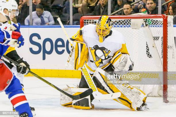 Pittsburgh Penguins goaltender Casey DeSmith makes shoulder save during the Pittsburgh Penguins and New York Rangers NHL game on March 14 at Madison...