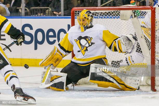 Pittsburgh Penguins goaltender Casey DeSmith prepares to make save during the Pittsburgh Penguins and New York Rangers NHL game on March 14 at...