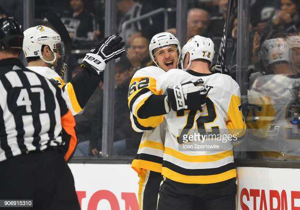 Pittsburgh Penguins Left Wing Carl Hagelin and Pittsburgh Penguins Right Wing Patric Hornqvist celebrate after the Penguins scored their first goal...