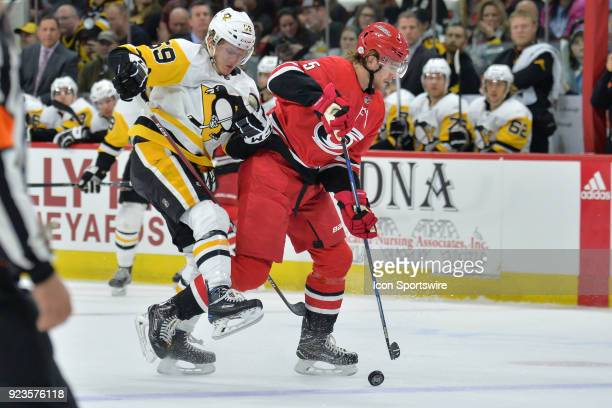 Pittsburgh Penguins Left Wing Jake Guentzel and Carolina Hurricanes Defenceman Noah Hanifin get tangled up during a game between the Pittsburgh...