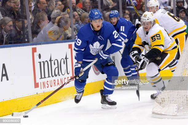 Pittsburgh Penguins Left Wing Jake Guentzel challenges Toronto Maple Leafs Center William Nylander during the NHL regular season game between the...