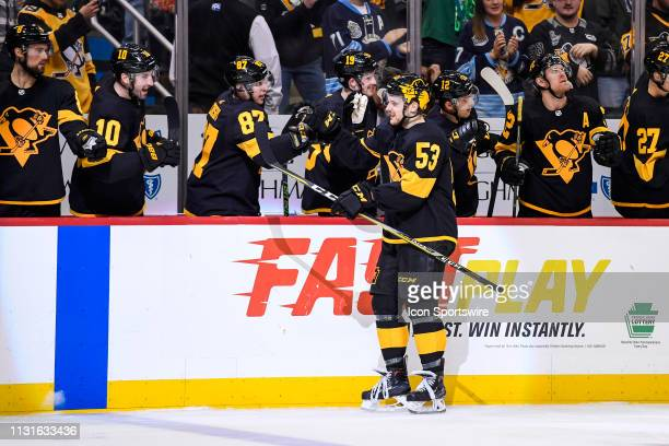 Pittsburgh Penguins Left Wing Teddy Blueger celebrates his goal with Pittsburgh Penguins Center Sidney Crosby on the bench during the third period in...
