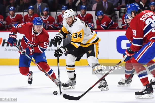 Pittsburgh Penguins Left Wing Tom Kuhnhackl tries to gain control of the puck while under pressure from Montreal Canadiens Winger Charles Hudon...