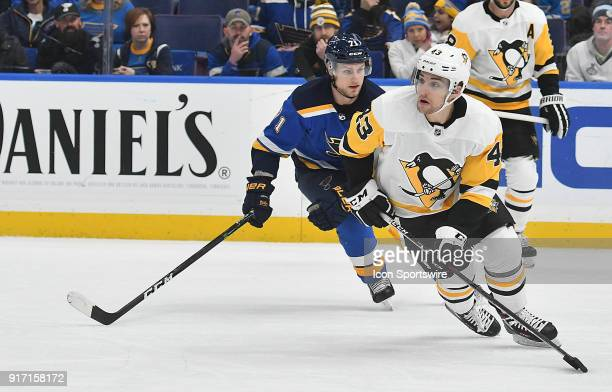 Pittsburgh Penguins leftwing Conor Sheary skates with the puck ahead of St Louis Blues left wing Vladimir Sobotka during a NHL game between the...