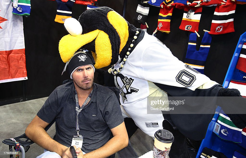 Pittsburgh Penguins mascot Iceburgh has some fun with Tony Pook of Hockey Sockey during 2013 NHL Exchange the annual NHL Licensed Products forum at the Consol Energy Center on July 30, 2013 in Pittsburgh, Pennsylvania.