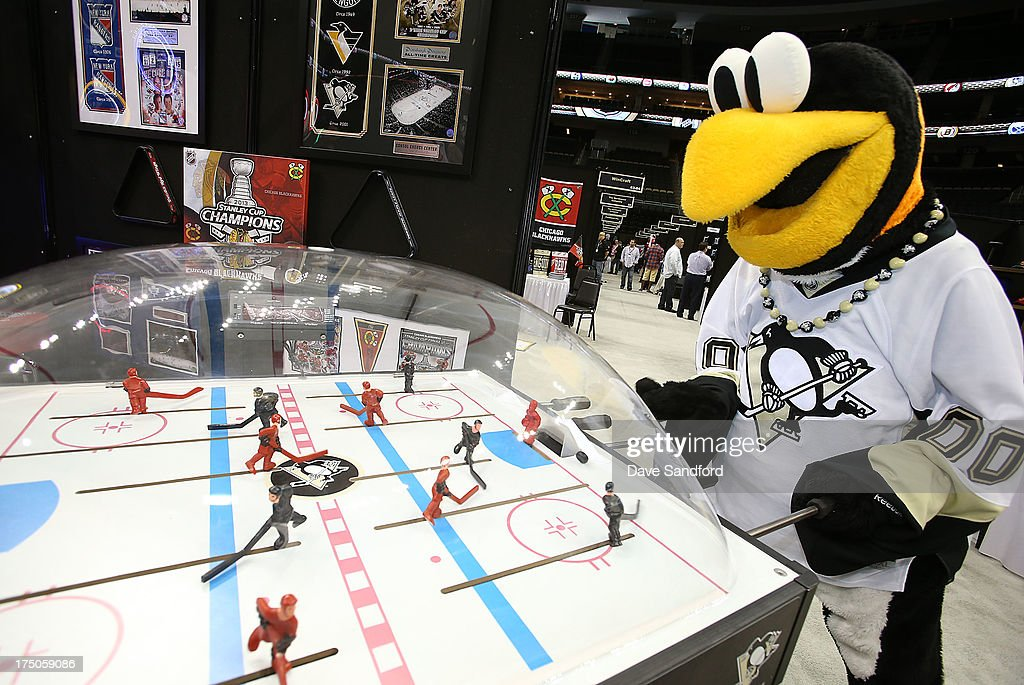 Pittsburgh Penguins mascot Iceburgh plays a game of bubble hockey during 2013 NHL Exchange the annual NHL Licensed Products forum at the Consol Energy Center on July 30, 2013 in Pittsburgh, Pennsylvania.