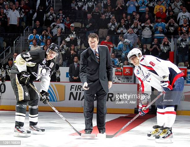 Pittsburgh Penguins owner Mario Lemieux drops the ceremonial puck between Evgeni Malkin of the Pittsburgh Penguins and Alex Ovechkin of the...