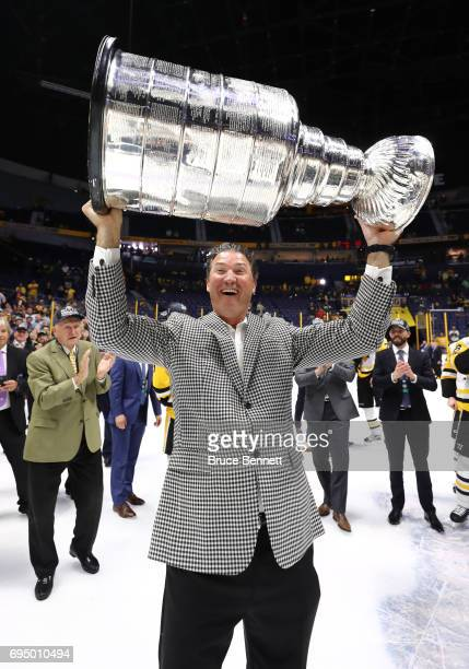 Pittsburgh Penguins owner Mario Lemieux raises the Stanley Cup Trophy after they defeated the Nashville Predators 2-0 in Game Six of the 2017 NHL...