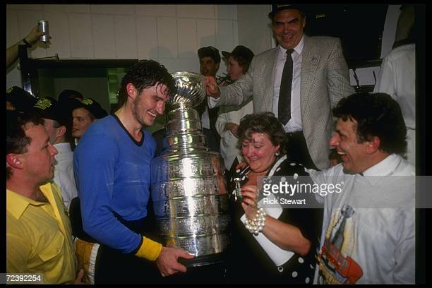 Pittsburgh Penguins players celebrate with the Stanley Cup.