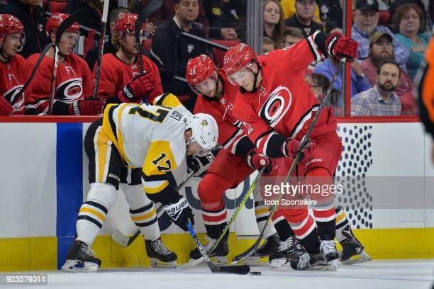 Pittsburgh Penguins Right Wing Bryan Rust fights for a puck with Carolina Hurricanes Defenceman Brett Pesce and Carolina Hurricanes Center Elias...