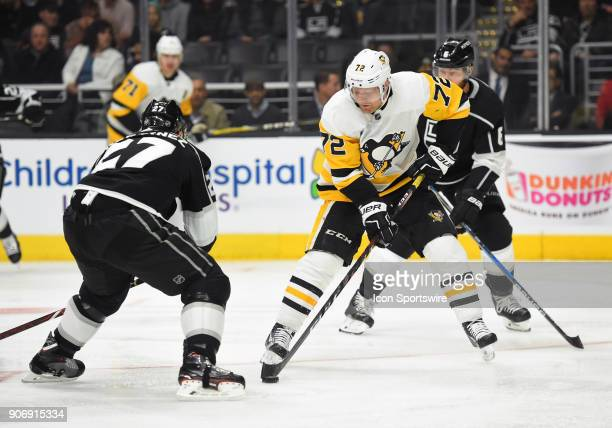 Pittsburgh Penguins Right Wing Patric Hornqvist brings the puck past Los Angeles Kings Defenseman Alec Martinez during an NHL game between the...