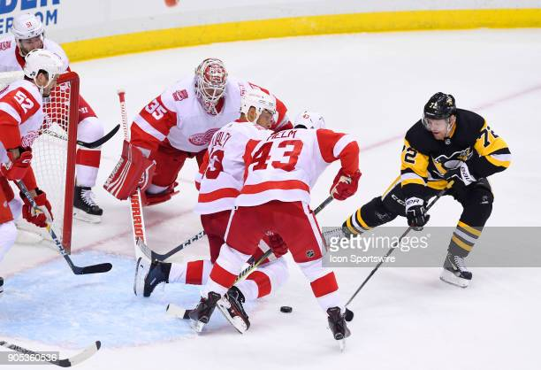 Pittsburgh Penguins Right Wing Patric Hornqvist goes for a loose puck in front of the net on Detroit Red Wings Goalie Jimmy Howard as Defenseman...