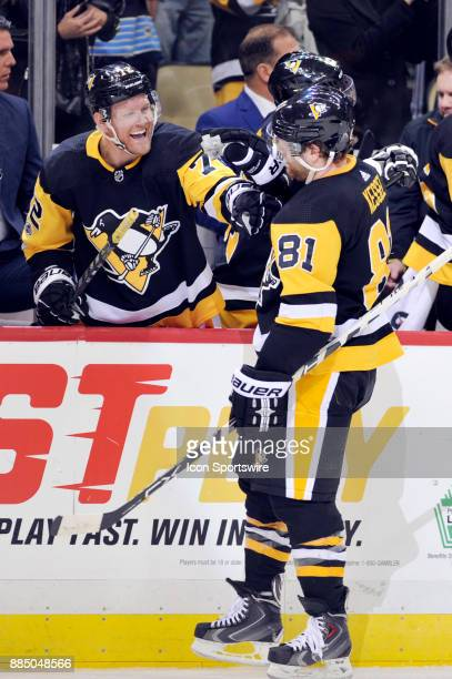 Pittsburgh Penguins Right Wing Phil Kessel celebrates his goal with Pittsburgh Penguins Right Wing Patric Hornqvist on the bench during the third...