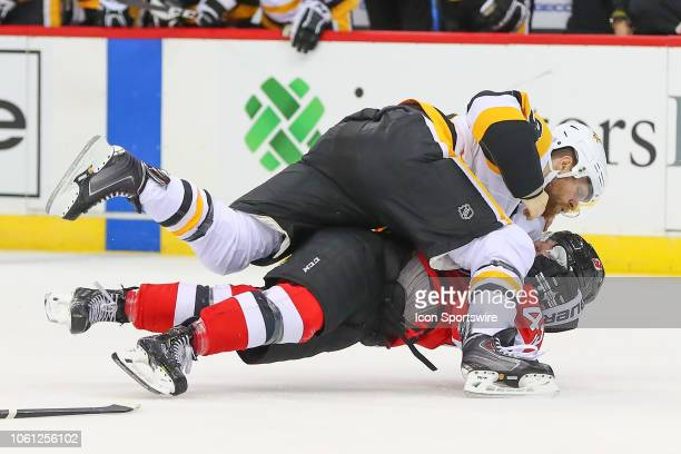 Pittsburgh Penguins right wing Phil Kessel fights with New Jersey Devils left wing Brett Seney during the second period of the National Hockey League...