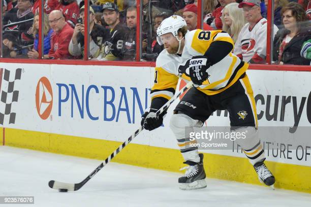 Pittsburgh Penguins Right Wing Phil Kessel looks to pass the puck from behind the net during a game between the Pittsburgh Penguins and the Carolina...
