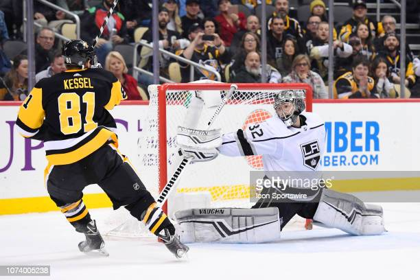 Pittsburgh Penguins Right Wing Phil Kessel scores the game winning goal past Los Angeles Kings Goalie Jonathan Quick during the overtime period in...