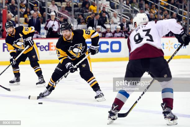 Pittsburgh Penguins Right Wing Phil Kessel skates the puck into the zone as Colorado Avalanche Left Wing Matt Nieto defends during the second period...