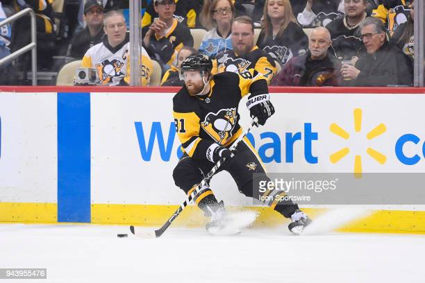 Pittsburgh Penguins Right Wing Phil Kessel skates with the puck during the second period in the NHL game between the Pittsburgh Penguins and the...