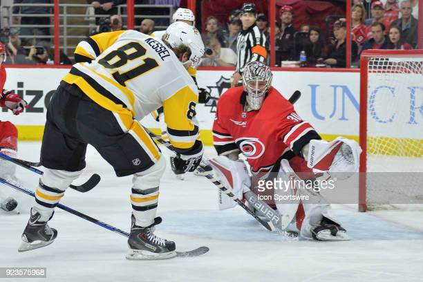 Pittsburgh Penguins Right Wing Phil Kessel slips the puck between the legs of Carolina Hurricanes Goalie Cam Ward for his second goal of the night...