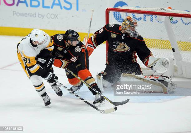 Pittsburgh Penguins rightwing Phil Kessel scores a goal past Anaheim Ducks defenseman Jacob Larsson and goalie John Gibson in the third period of a...