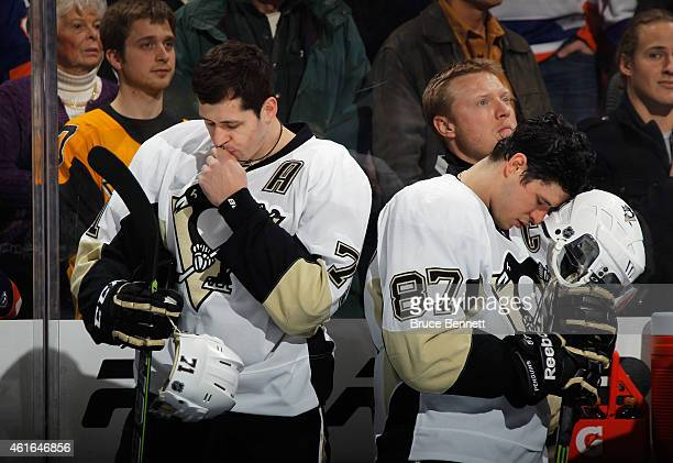 Pittsburgh Penguins stars Evgeni Malkin and Sidney Crosby pause prior to their game against against the New York Islanders at the Nassau Veterans...