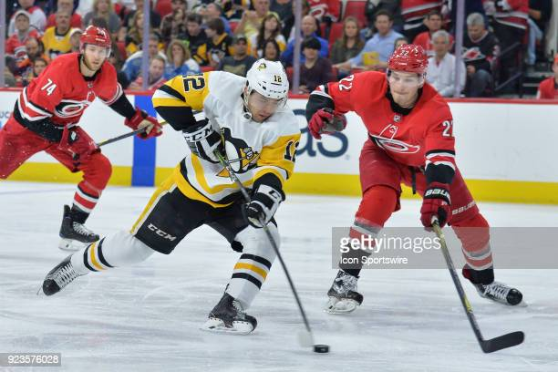 Pittsburgh Penguins Winger Dominik Simon charges towards the net defended by Carolina Hurricanes Defenceman Brett Pesce during a game between the...