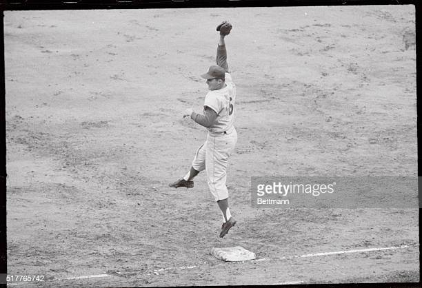 Pittsburgh Pennsylvania Dodgers' Ron Fairly with a great catch makes an out on Pirate thirdbaseman Don Hoak in the fourth inning of the first of a...
