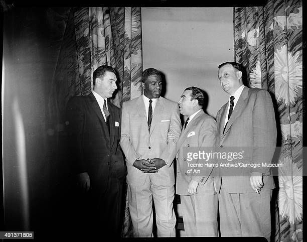 Pittsburgh Pirates baseball player Sid Gordon Brooklyn Dodgers player Jackie Robinson Judge Samuel A Weiss and Duquesne University basketball coach...