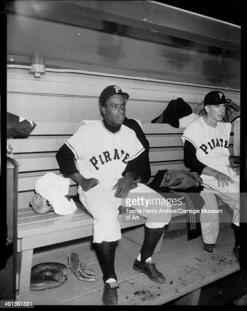 Pittsburgh Pirates baseball players Curtis 'Curt' Roberts and Bob Skinner seated in the dugout at Forbes Field Pittsburgh Pennsylvania circa 19541956