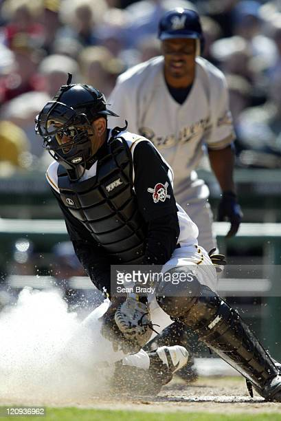 Pittsburgh Pirates catcher Benito Santiago digs for the ball during action against the Milwaukee Brewers at PNC Park on April 4 2005 in Pittsburgh...