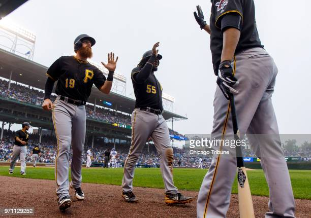 Pittsburgh Pirates Colin Moran and Josh Bell celebrate scoring on a basesloaded triple by teammate Gregory Polanco in the sixth inning against...