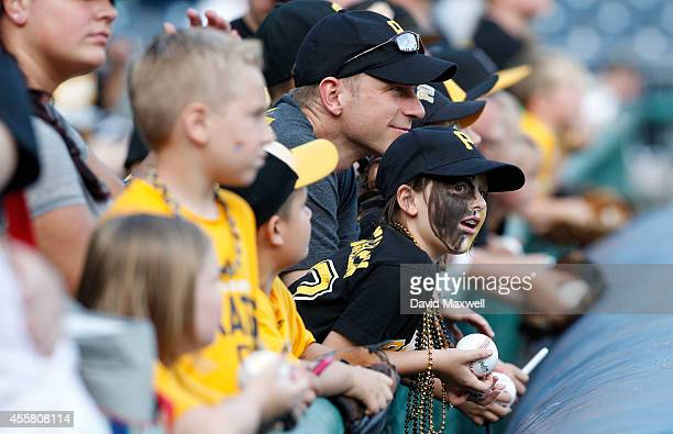 Pittsburgh Pirates fans including Ella Reed age 8 of Pittsburgh Pennsylvania watch players warm up and wait for autographs before the start of the...