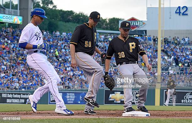 Pittsburgh Pirates first baseman Travis Ishikawa and pitcher Charlie Morton arrive to first base ahead of the Kansas City Royals' Alex Rios for the...