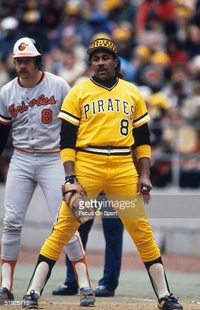 Pittsburgh Pirates' first baseman Willie Stargell stands guard next to Baltimore Orioles' Dave Skaggs during the World Series at Three Rivers Stadium...