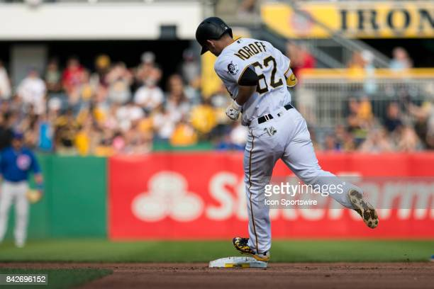 Pittsburgh Pirates Infield Max Moroff touches second base after hitting a home run during the game between the Chicago Cubs and the Pittsburgh...