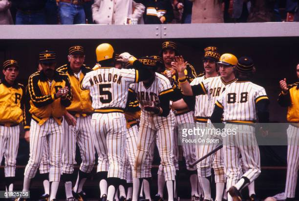 Pittsburgh Pirates' infielder Bill Madlock gets a hero's welcome from his teammates as he walks back to the dugout during the World Series against...