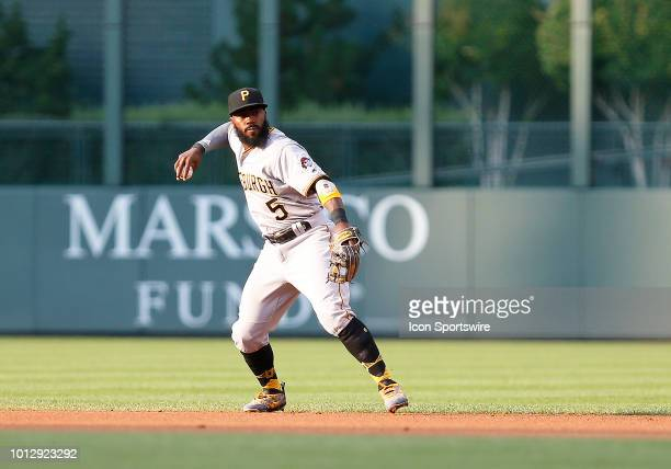 Pittsburgh Pirates infielder Josh Harrison makes a throw to first base for an our during the first inning of a regular season game between the...