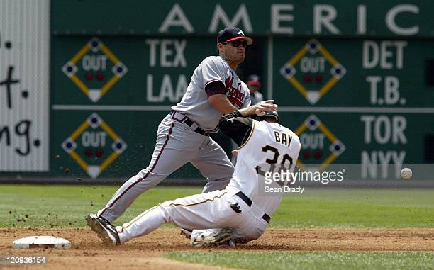 Pittsburgh Pirates Jason Bay slides safely into second base as Atlanta's Marcus Giles attempts to grab the ball during action at PNC Park in...