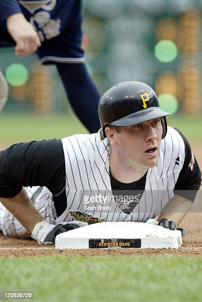 Pittsburgh Pirates Jason Bay slides under the tag for a triple during action against San Diego at PNC Park in Pittsburgh Pennsylvania on June 4 2006