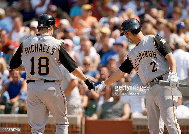 Pittsburgh Pirates' Jason Michaels left is congratulated on his home run by teammate Jack Wilson in the top of the sixth inning against the Chicago...