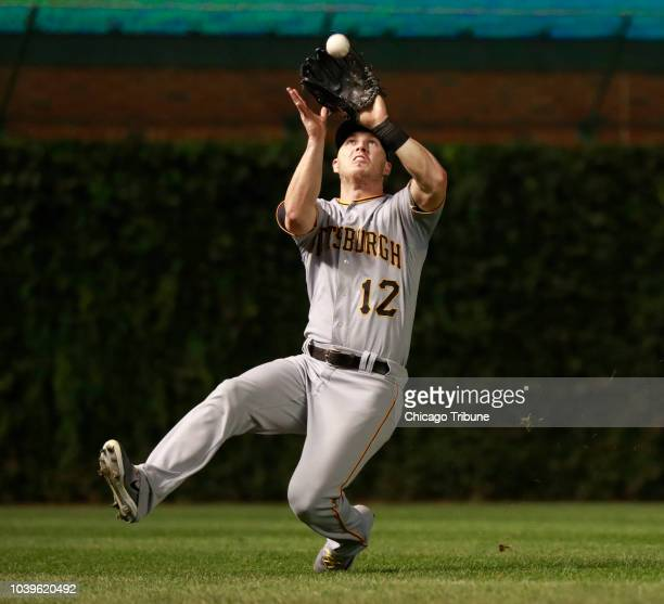 Pittsburgh Pirates left fielder Corey Dickerson catches the fly out by Chicago Cubs left fielder Kyle Schwarber during the fourth inning of their...
