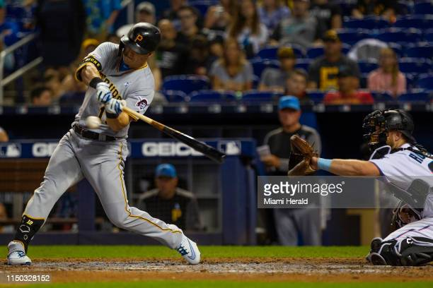 Pittsburgh Pirates left fielder Corey Dickerson gets called for a strike after missing an 81 mph curve ball against the Miami Marlins on Sunday June...