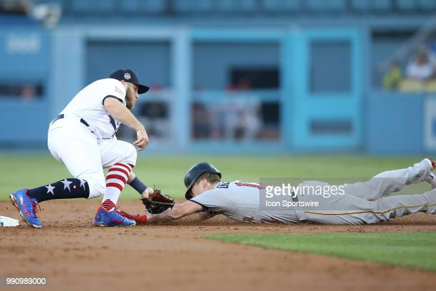 Pittsburgh Pirates left fielder Corey Dickerson gets thrown after by Los Angeles Dodgers first baseman Max Muncy while trying to steal second base in...