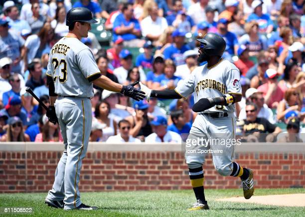 Pittsburgh Pirates left fielder Josh Harrison and Pittsburgh Pirates third baseman David Freese celebrate the run during the game between the...