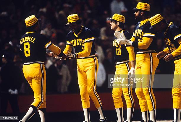 Pittsburgh Pirates' Omar Moreno greets Willie Stargell as teammates look onward during player introductions for the World Series against the...