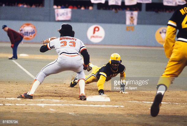 Pittsburgh Pirates' outfielder Omar Moreno dives back to second base while Baltimore Orioles' first baseman Eddie Murray waits for the throw during...