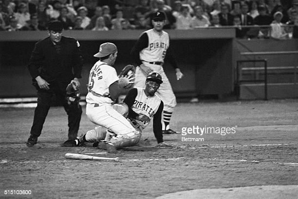 Pittsburgh Pirates' Roberto Clemente is out at the plate as St Louis Cardinals' catcher Tim McCarver blocking the plate takes the relay throw for the...