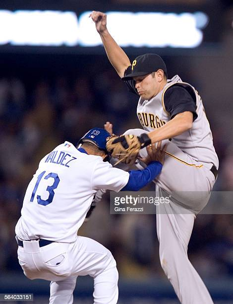 Pittsburgh Pirates second baseman Freddy Sanchez kicks Dodgers Wilson Valdez while chasing an overthrown on a wild pitch in the bottom of the ninth...
