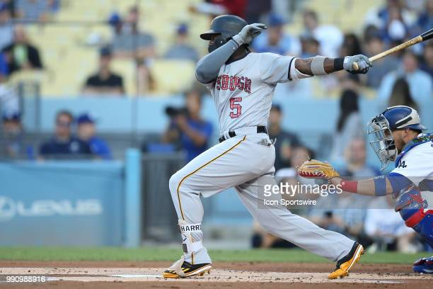 Pittsburgh Pirates second baseman Josh Harrison eyes his ball as it sails foul in the game between the Pittsburg Pirates and the Los Angeles Dodgers...