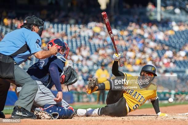 Pittsburgh Pirates second baseman Josh Harrison gets hit by a pitch in the eighth inning and eventually left the game during an MLB game between the...
